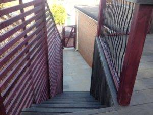 new wooden steps with wooden rails