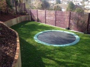 trampoline installed in back garden turf