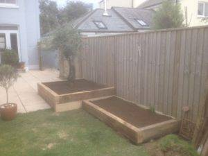 new wooden raised beds