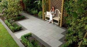 lady sat on bench in recently designed garden