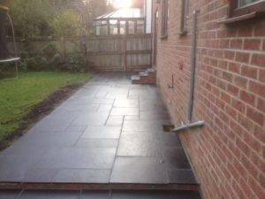 black paving in back garden