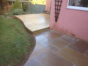 new paving and decking around pink house