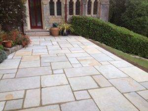 new paving and turf installed in back garden