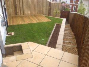 new turf, decking and garden fence