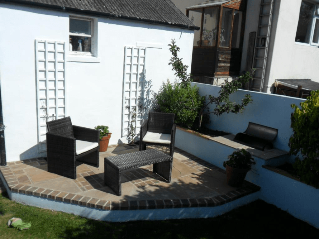 new paving area with table and chairs