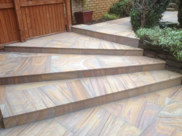 Textured patio slabed steps in rear garden