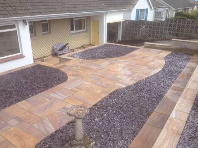 Gravel and designer patio front garden