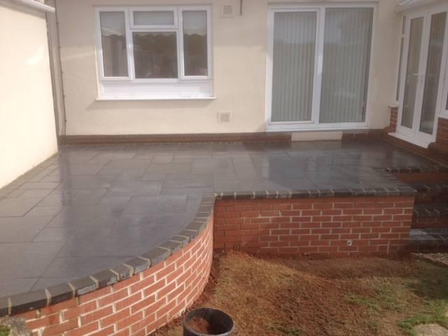 raised patio area - black slate patio finish 2