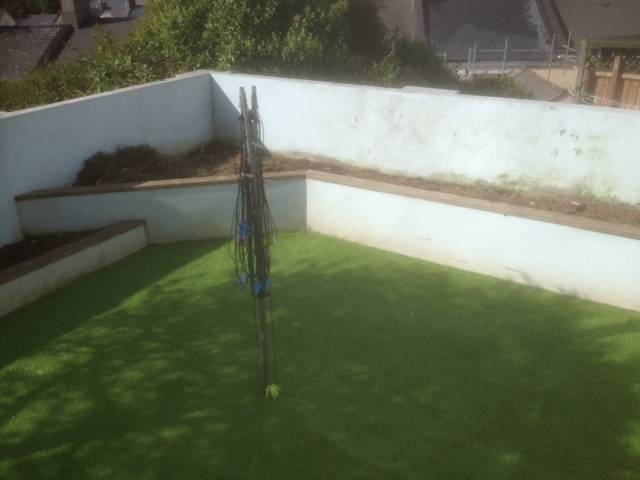 Walled and turfed rear garden