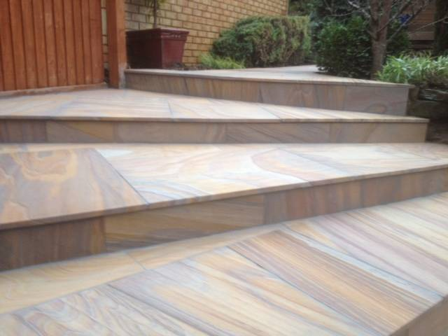 Textured paved patio to rear garden